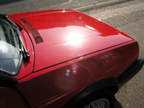 yet another red golf wich had faded paintwork, it looks okay after buffing!