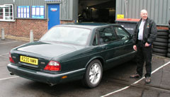 Part valeted XJS, looking dull because the wax is still on it.