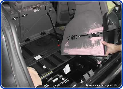 the paint had poured down beneath the carpets into the spare wheel compartment.