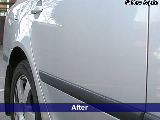 The same car after Paintless Dent Removal.