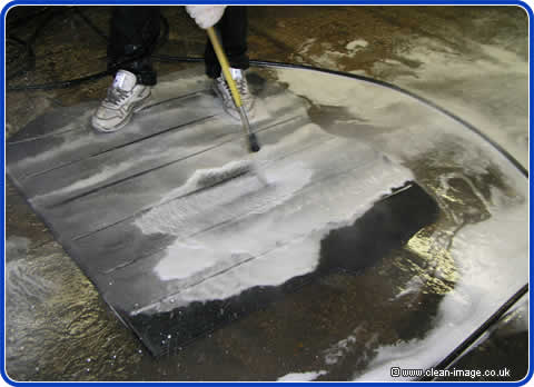 Mark hot pressure washes the boot carpet to remove silt and all traces of the flood.
