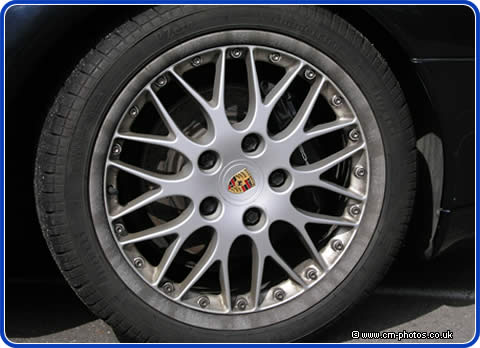 Alloy wheel with corroded split rim, this is common on this kind of Porsche wheel
