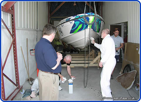The Neptune Honda Powerboat suspended while we clean the hull.