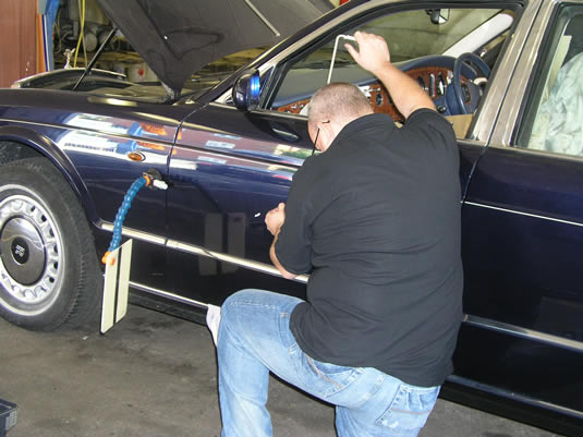 Chris removes dents with PDR.
