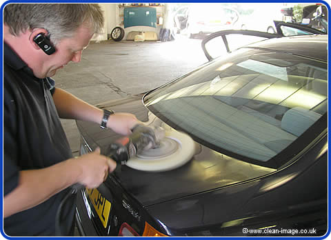 Gary the scratch remover repairingthe boot of a BMW with a ratary buffing machine. this was then finished by polishing with a machine polisher.